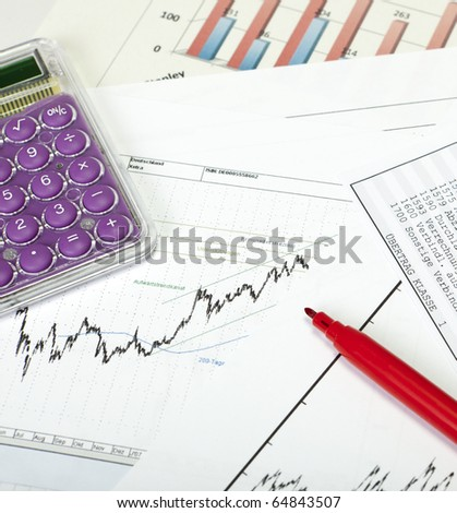 Stockcharts with Calculator and red pencil - stock photo