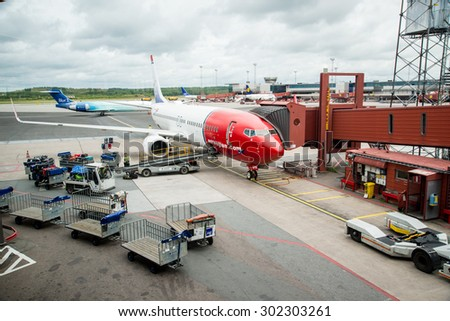 STOCKHOLM AIRPORT, SWEDEN - 22 JULY 2015: Norwegian plane  on the base on Stockholm Arlanda Airport. Norwegian operates over 100 aircraft and is one of the biggest low-cost airline company in Europe.