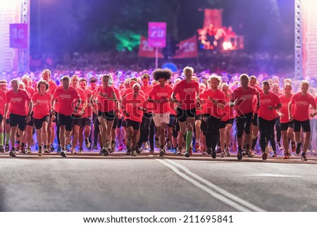 STOCKHOLM - AUG, 16: After start of one of many groups in the Midnight Run (Midnattsloppet) event. Aug 16, 2014 in Stockholm, Sweden - stock photo