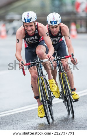 STOCKHOLM - AUG, 23: Brownlee brothers cycling into a curve in the rain at the Mens ITU World Triathlon Series event August 23, 2014 in Stockholm, Sweden