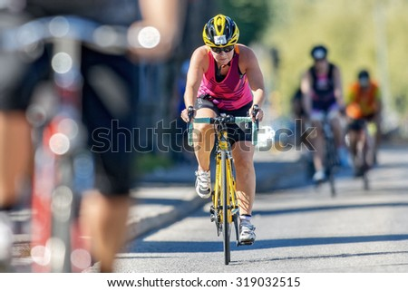 STOCKHOLM - AUG 23, 2015: Focused triathlete cyclist in front view at the ITU World Triathlon event in Stockholm.