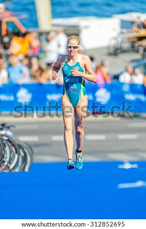 STOCKHOLM - AUG 22, 2015: Gillian Backhouse (AUS) running on blue mat at the Womens ITU World Triathlon series event in Stockholm.