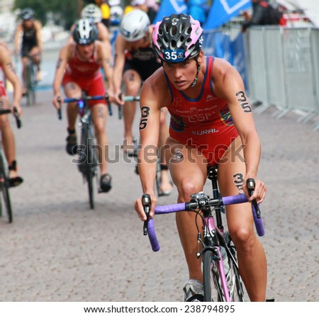 STOCKHOLM - AUG 23, 2014: Maria Ortega, front view cycling in the Women's ITU World Triathlon series event August 23, 2014 in Stockholm, Sweden - stock photo
