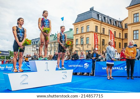 STOCKHOLM - AUG, 23: Podium cermony at the womens ITU World Triathlon Series event August 23, 2014 in Stockholm, Sweden. Sarah Groff, Andrea Hewitt, Nicky Samuels - stock photo