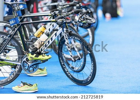 STOCKHOLM - AUG, 23: Row of triathlon bikes with all other equipment at the transition zone in the Mens ITU World Triathlon Series event Aug 23, 2014 in Stockholm, Sweden - stock photo