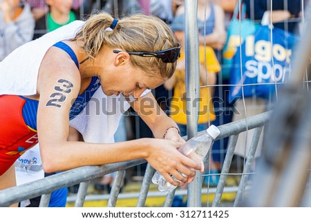 STOCKHOLM - AUG 22, 2015: Tamara Gomez Garrido (ESP) just after the goal taking her breath at the Womens ITU World Triathlon series event in Stockholm. - stock photo