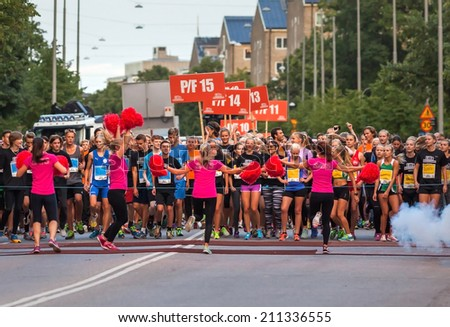 STOCKHOLM - AUG, 16: The start of little midnight run for boys and girls, fifteen years old. (Midnattsloppet) event. Aug 16, 2014 in Stockholm, Sweden