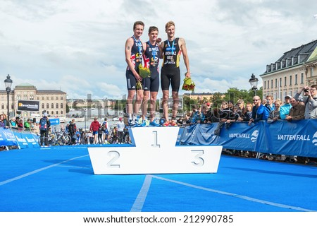 STOCKHOLM - AUG, 23: The three podium winners in the Mens ITU World Triathlon Series event August 23, 2014 in Stockholm, Sweden. Alistair Brownlee got the second place. Brownlee, Brownlee and Buchholz - stock photo