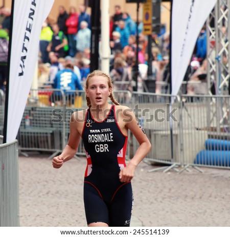 STOCKHOLM - AUG 23, 2014: Triathlete Lois Rosindale (GBR) running in the triathlonin the Women's ITU World Triathlon series event August 23, 2014 in Stockholm, Sweden - stock photo