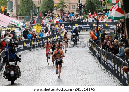 STOCKHOLM - AUG 23, 2014: Triathlete Sarah Groff in the lead before a group of competitors in the Women's ITU World Triathlon series event Aug 23, 2014 in Stockholm, Sweden - stock photo