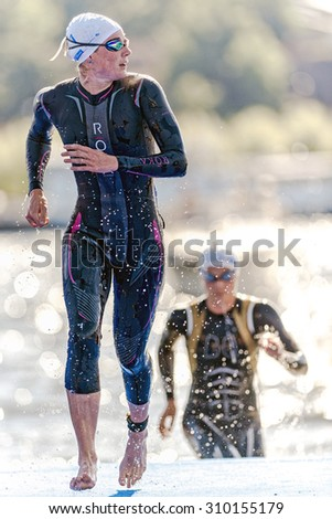 STOCKHOLM - AUG 22, 2015: Triathlete up and looking for the field at the Womens ITU World Triathlon series event in Stockholm. - stock photo