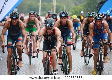 STOCKHOLM - AUG 23: Triathletes Thomas Bishop(GBR), Benjamin Shaw(IRL) cycling in the Men's ITU World Triathlon series event Aug 23, 2014 in Stockholm, Sweden - stock photo