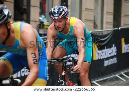 STOCKHOLM - AUG 23: Triathletes Valentin Meshcheryakov, Luciano Taccone cycling in the Men's ITU World Triathlon series event Aug 23, 2014 in Stockholm, Sweden - stock photo