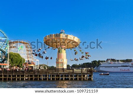 STOCKHOLM- AUGUST 04: Carousel in the amusement park of Grona Lund on August 4, 2012 in Stockholm, Sweden.  This is the most popular city-center amusement park in Sweden  and has over 30 attractions. - stock photo