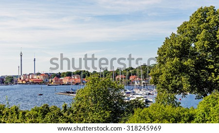 STOCKHOLM - AUGUST 10, 2015: Distant view on Grona Lund, the amusement park on the Djurgarden Island. The park is located amongst the old 19th century buildings originally designed not for the park. - stock photo