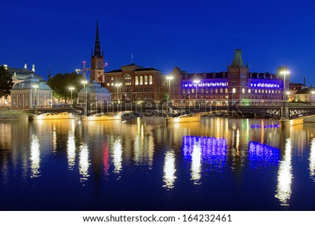 STOCKHOLM - AUGUST 26: Evening view of Riddarholmen island with Norstedts building on August 26, 2013 in Stockholm, Sweden. Norstedts is Swedens oldest publishing house, founded in 1823.