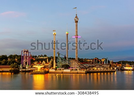 STOCKHOLM - AUGUST 10, 2015: Grona Lund amusement park with a unique location on the Djurgarden island. The park is located amongst the old 19th century buildings originally designed  not for the park - stock photo
