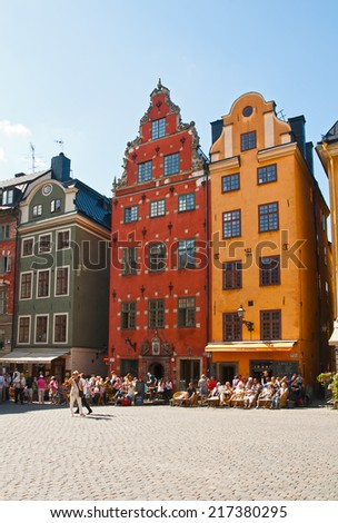 STOCKHOLM - AUGUST 18, 2011 - medieval Stortorget square in Stockholm, Sweden. Tourists visiting the sights of Stockholm and relax in the outdoor cafes. - stock photo