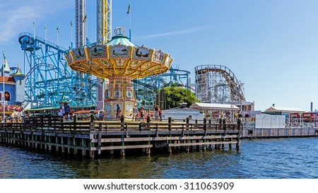 STOCKHOLM - AUGUST 10, 2015: Merry-go-round in Grona Lund amusement park on the Djurgarden island. The park is located among the old 19th century buildings originally designed not for the park. - stock photo