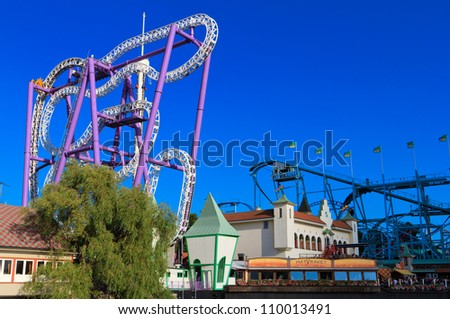 STOCKHOLM- AUGUST 4: Roller coasters in amusement park of Grona Lund on August 4, 2012 in Stockholm,Sweden.  This is the most popular city-center amusement park in Sweden  and has over 30 attractions. - stock photo