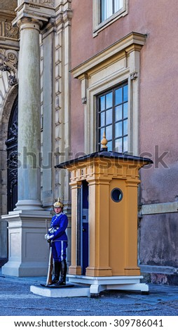 STOCKHOLM - AUGUST 10, 2015: The wardress on duty in front of the Royal Palace in Stockholm. The Royal Guard was established in 1523 and continuously guards the Royal Palace since then.
