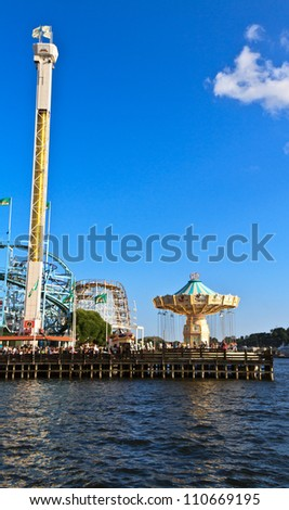 STOCKHOLM- AUGUST 04: View of amusement park Grona Lund on August 4, 2012 in Stockholm, Sweden.  This is the most popular city-center amusement park in Sweden  and has over 30 attractions. - stock photo