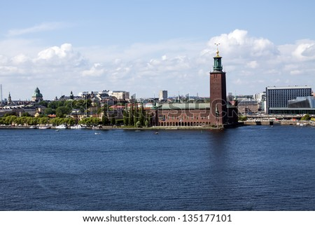 Stockholm city skyline and city hall on blue water under blue sky - stock photo