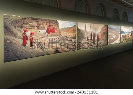 STOCKHOLM, DEC 27: Display of Jimmy Nelson photographs in his Exhibition at Fotografiska Museum. December 2014 in Stockholm, Sweden. Exhibition: Before they pass away. - stock photo