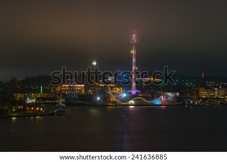 STOCKHOLM, DEC 31: View over Stockholm during New Years evening with Skansen and Grona Lund, Stockholm, Sweden in December 31, 2014. Foggy night. - stock photo