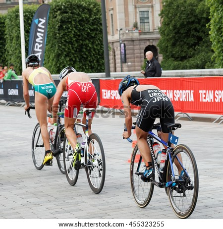 STOCKHOLM - JUL 02, 2016: Rear side view of  triathlete cyclists Ueda, Vilic and Van Coevorden in the Women's ITU World Triathlon series event July 02, 2016 in Stockholm, Sweden