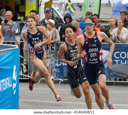 STOCKHOLM - JUL 02, 2016: Triathletes Jenkins, Ueda and True running in a curve in the Women's ITU World Triathlon series event July 02, 2016 in Stockholm, Sweden