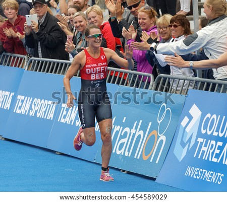 STOCKHOLM - JUL 02, 2016: Winning triathlete Flora Duffy (BER) running at the finish in the Women's ITU World Triathlon series event July 02, 2016 in Stockholm, Sweden