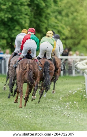 STOCKHOLM - JUNE 6: Jockeys passed by into a curve at the Nationaldags Galoppen at Gardet. June 6, 2015 in Stockholm, Sweden. - stock photo