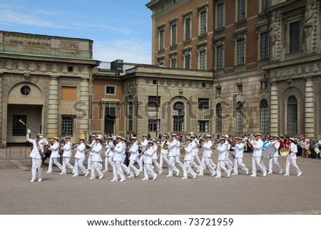 STOCKHOLM - JUNE 1: The Royal Swedish Navy Cadet Band performs for tourists during the changing of the guard on June 1, 2010 in Stockholm, Sweden.
