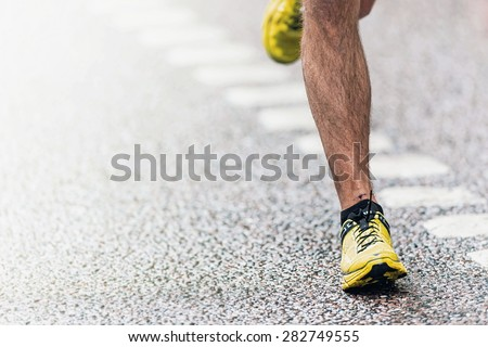 STOCKHOLM - MAY 30: Closeup of mans foot touching the asphalt at ASICS Stockholm Marathon 2015. May 30, 2015 in Stockholm, Sweden. Runners from 101 nations were registered in 2015 - stock photo