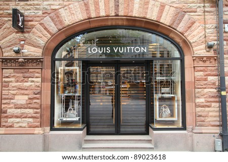 STOCKHOLM - MAY 31: Louis Vuitton shop on May 31, 2010 in Stockholm. Forbes claims Louis Vouitton was the most powerful luxury brand in the world in 2008 with $19.4bn USD value. LV was founded in 1854 - stock photo