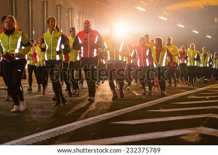STOCKHOLM - 22 NOV: Big group of runners in the Stockholm Tunnel Run. Stockholm, 22 November 2014. A 10 km long race in Northern Link tunnelsystem before it opens for traffic. - stock photo