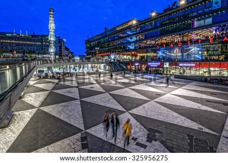 STOCKHOLM - OCT 10, 2015: Sergels torg during late evening with Kulturhuset and the obelisk in the city center. - stock photo