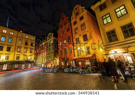 STOCKHOLM, OCT 10: Stortorget in the old town (Gamla stan) in Stockholm during evening. Restaurants and citylife. Filter applied.