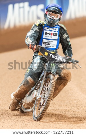 STOCKHOLM - SEPT 26, 2015: Andreas Jonsson from Sweden looking at the scoreboard after the heat at the TEGERA Stockholm FIM Speedway Grand Prix at Friends Arena in Stockholm.