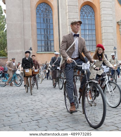 STOCKHOLM - SEPT 24, 2016: Group of elegant cycling people wearing old fashioned tweed clothes in the Bike in Tweed event September 24, 2016 in Stockholm, Sweden
