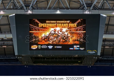 STOCKHOLM - SEPT 25, 2015: LCD jumbotron showing advert for the event at the TEGERA Stockholm FIM Speedway Grand Prix at Friends Arena in Stockholm. - stock photo