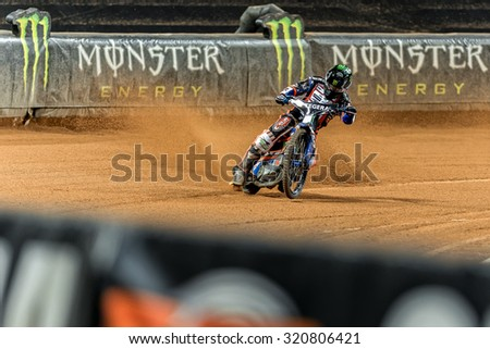 STOCKHOLM - SEPT 25, 2015: Speedway driver in a Monster advert curve at the TEGERA Stockholm FIM Speedway Grand Prix at Friends Arena in Stockholm. - stock photo