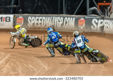 STOCKHOLM - SEPT 26, 2015: Speedway racer passing by with Chris Holder behind at the TEGERA Stockholm FIM Speedway Grand Prix at Friends Arena in Stockholm. - stock photo