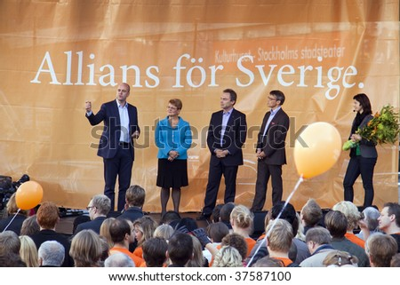 STOCKHOLM - SEPT 19: Swedish Prime minister Fredrik Reinfeld, and ministers for education, Bjorklund, for Energy, Olofsson, for Health, Hagglund, talking to the public, September 19, 2009 in Sweden.