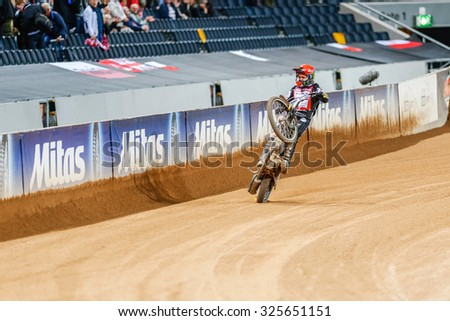 STOCKHOLM - SEPT 26, 2015: Tai Woffinden doing a wheelie after his victory at the TEGERA Stockholm FIM Speedway Grand Prix at Friends Arena in Stockholm. - stock photo