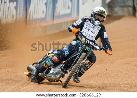 STOCKHOLM - SEPT 25, 2015: Tai Woffinden from Great Britain in a curve at the TEGERA Stockholm FIM Speedway Grand Prix at Friends Arena in Stockholm. - stock photo
