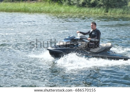 Stockholm, Sweden - 07.21.2017: A man driving a watercraft a sunny day in Stockholm
