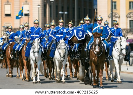 STOCKHOLM, SWEDEN - APRIL 20, 2016: Swedish horse guard on duty at the Royal Palace in Stockholm. Norrbro - stock photo