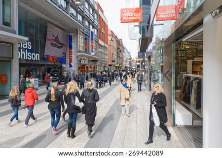 STOCKHOLM, SWEDEN - APRIL 8: The most popular shopping street at Drottningatan in Stockholm, April 8, 2015 in Stockholm, Sweden. - stock photo
